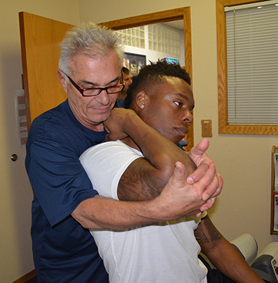 Dr. Nelson Vetanze adjusts Brandon Marshall Denver Broncos